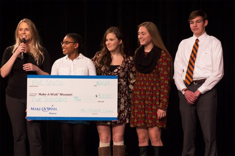 The Stuco officers handing a check to a Make-a-Wish representative. This year, they granted a boy named Noah's wish.