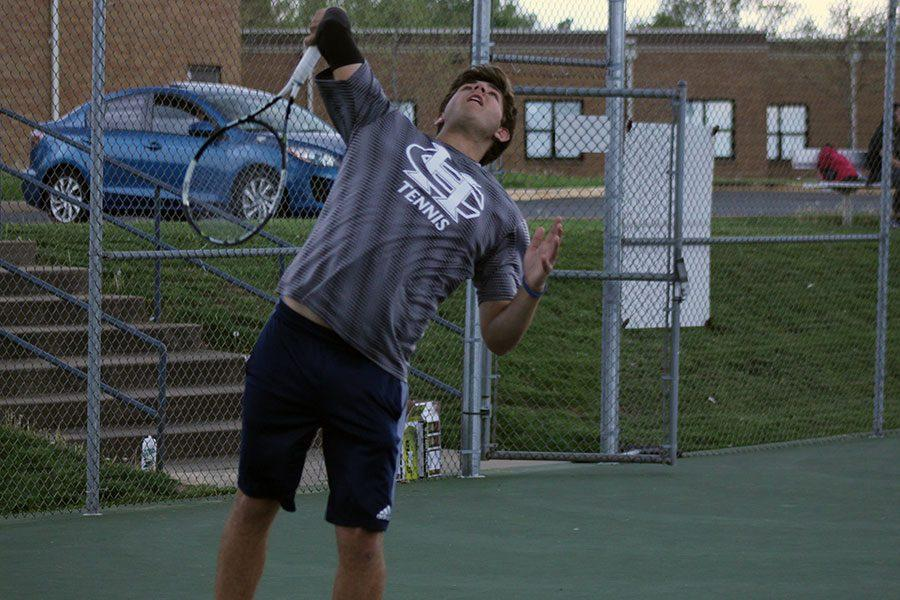 Matt Vandiver, a senior who will be a key player on this year's team, serves the ball during a match last year.