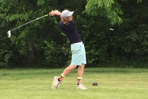 Senior C.J. Eddy drives the ball during the sectional tournament last season. The boys golf team got off to a rainy start this week and last.
