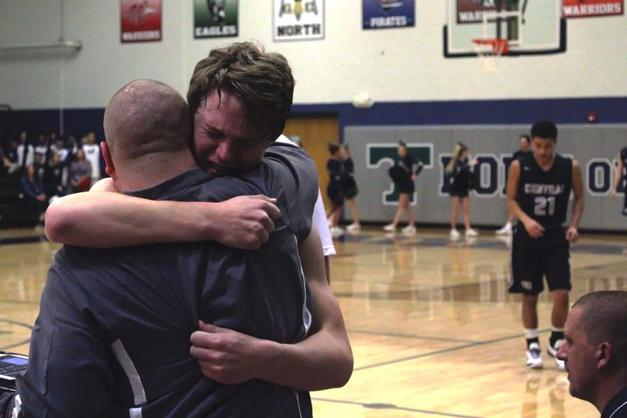 Kaleb Cissell's uncle and assistant coach, Keith, consoles him after the tough loss. The team lost by 14 to Timberland in  quarterfinals on Feb. 28.