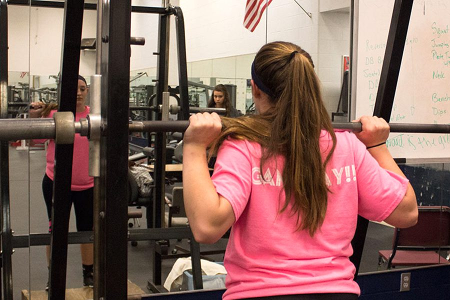 Kaitlyn+Chadwick+performing+the+pre+squat+form%2C+showing+you+how+it+is+done.