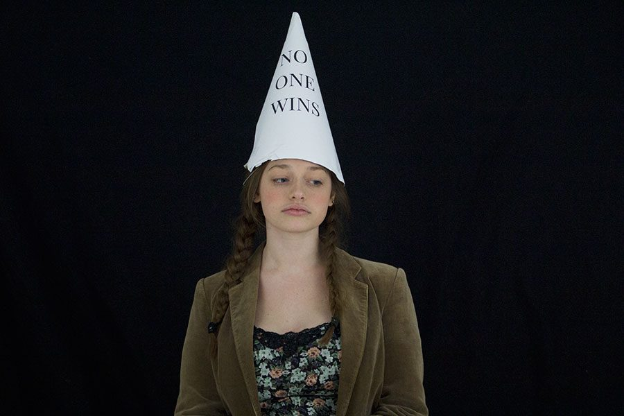 Mackenize Morris displays nobody wins when others do not respect perspective. She is wearing a dunce cap saying