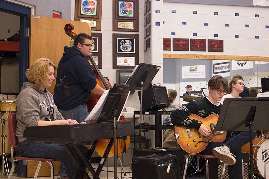 Members of jazz band Kayleigh Ammond, Sam Eckhoff, Bill Sander, Jake Leubbert practice in class. Kayleigh Ammond is one of the seniors who earned a one rating at districts.