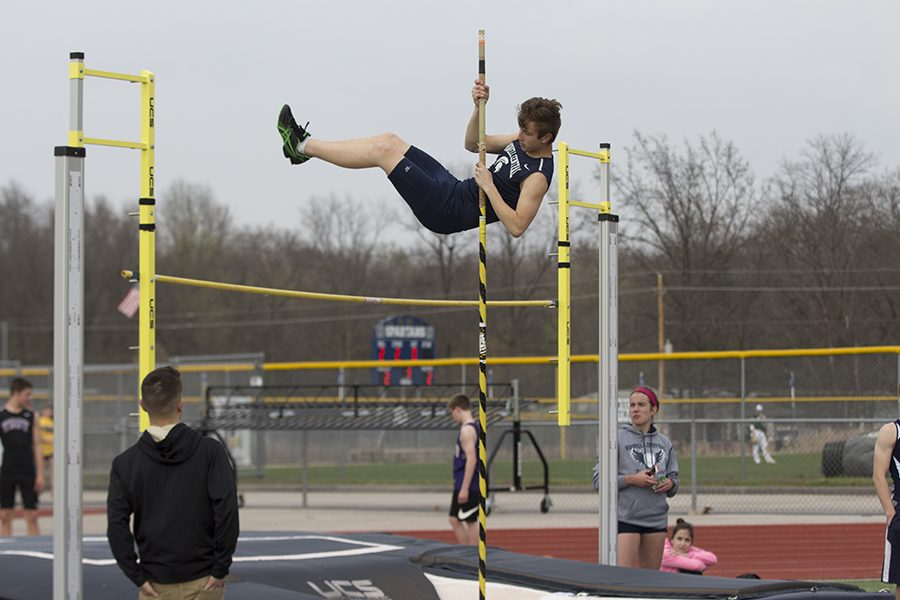 Sophomore Trent Kreienheder soars over the bar at track meet. Task force will be discussing activity fees that sports and clubs might be charged