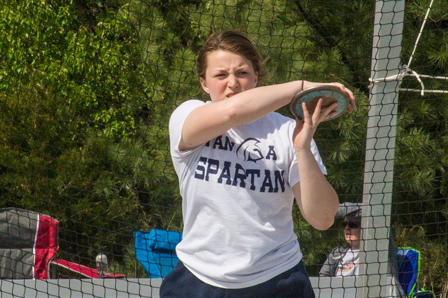 Junior Olivia Green practices throwing discus. She hopes to qualify for state.
