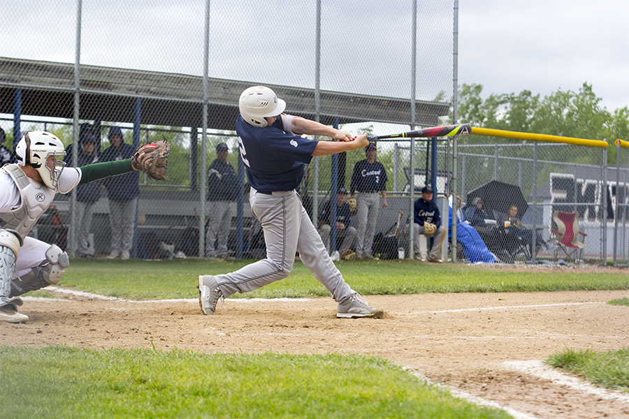 Baseball player swings at the plate. Seniors have wrapped up regular season and play Districts Monday