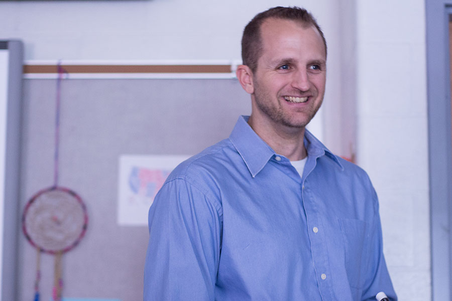 Mr.+Beckmann+smiles+as+he+tells+a+joke+to+his+class.+He+teaches+both+AP+Government+and+Contemporary+Issues.+