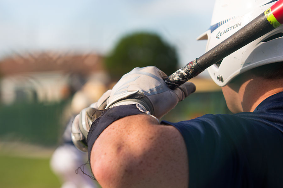 An unidentified player readies the bat for his swing and hopeful hit. The varsity team finished this year with a record of 15 wins against 12 losses.