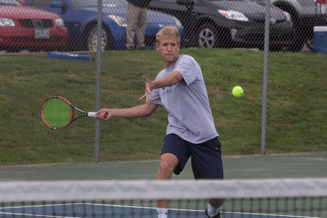 Junior Jack Pordea during his championship singles match. He defeated his opponent and came in first in number one singles.