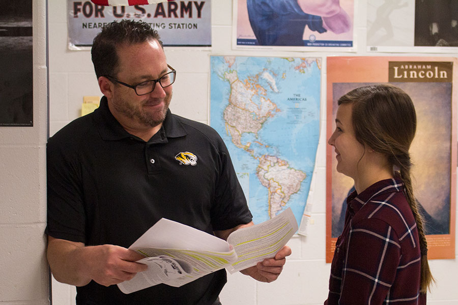 Mr. Lober helps a student with her work. Mr. Lober teaches both AP European History and World History.