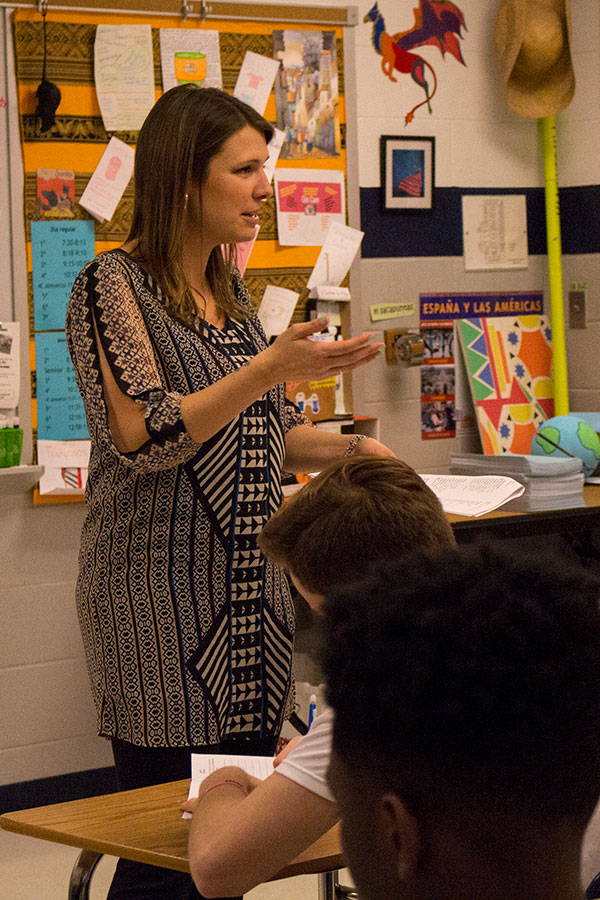 Mrs. Mair intently instructs students in her Spanish class. She runs an interactive classroom environment.