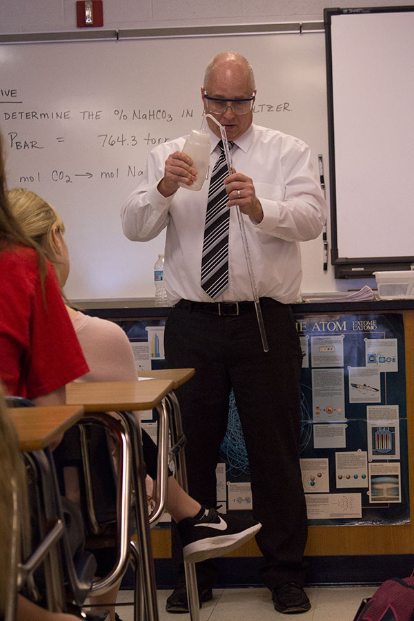 Mr. Koz demonstrates an experiment for his Pre-AP Chemistry class. He teaches Pre-AP Chemistry as well as AP Chemistry.