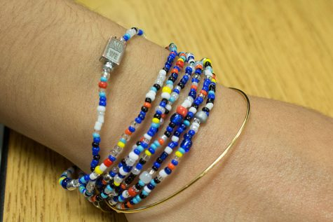 A rafiki bracelet worn by an FHC student. Each bracelet came with a WE day charm.