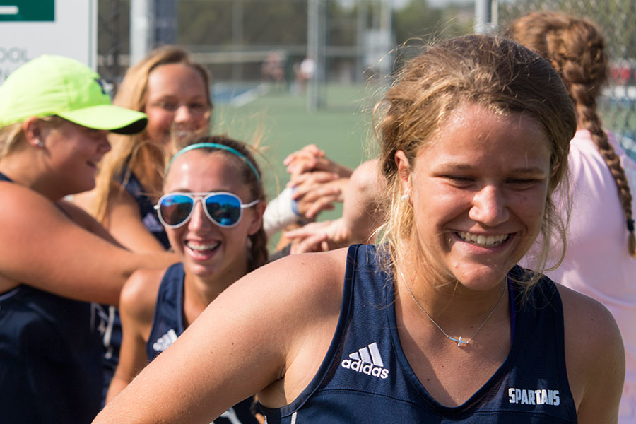 Running+through+a+bridge+created+by+their+teammates%2C+junior+Tori+Ikeda+and+sophomore+Mackenzie+Jones+after+defeating+their+opponents+from+St.+Dominic+on+Sept.+1.+