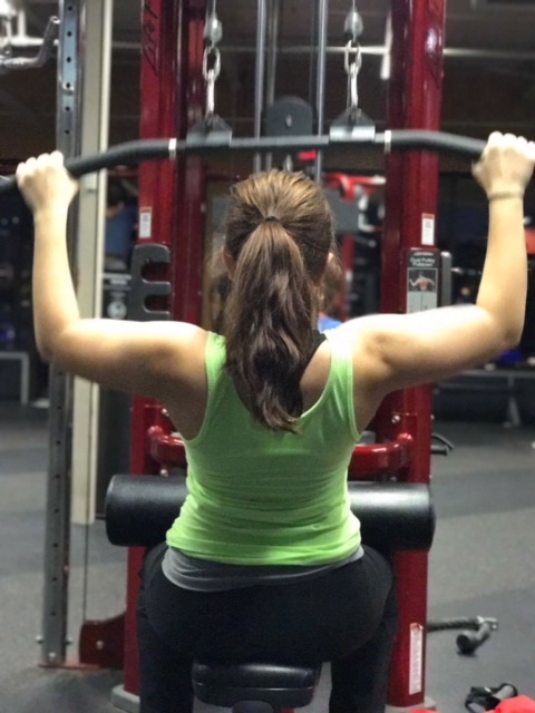 For back and bicep day, doing lateral pull showing off my back muscles. One of my favorite workouts to do.