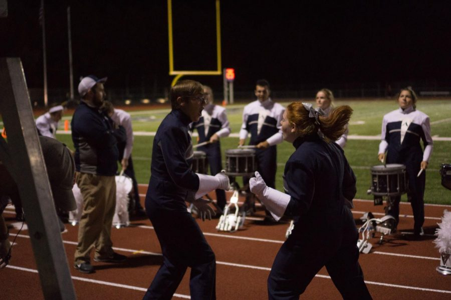 Two drum majors, Amy Wilkerson and Max Venker, celebrate their performance .