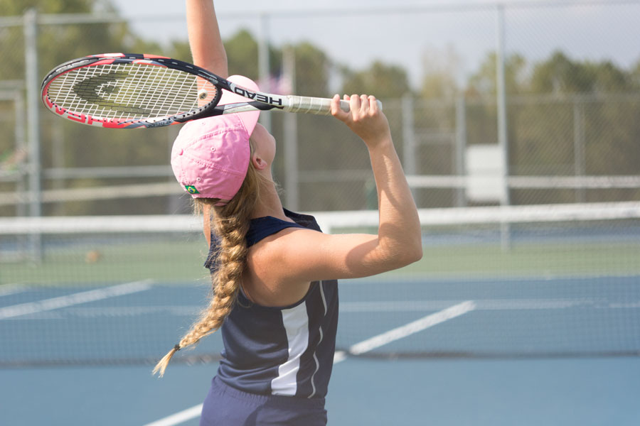 Junior Brynlee Hendricks competes with intensity during the district tournament. Although she did not advance to sectionals, she is still content with her overall performance and her season as a whole.