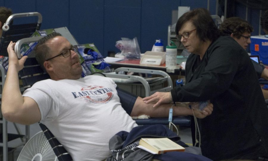 Donald Lober donates blood during the HOSA blood drive. The blood drive would continue to collect blood from other students as well as teachers for the rest of the day
