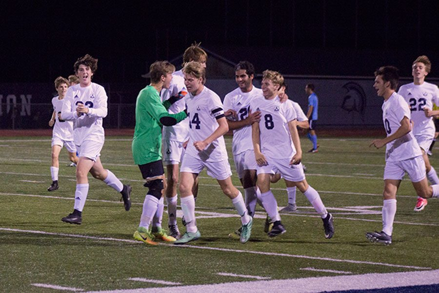 Senior+Brandon+Baumgartner+celebrates+with+his+teammates+after+he+scored+a+goal+to+tie+the+game+2-2.+The+boys+met+in+the+center+of+the+field+to+congratulate+Brandon+on+a+great+goal.
