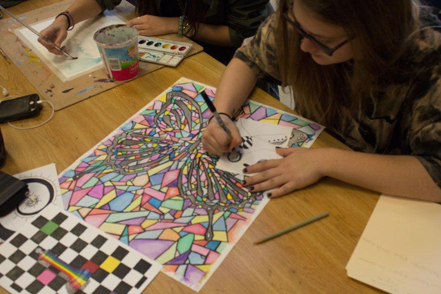 Senior Nina Siefert designs her trigger for the gallery.