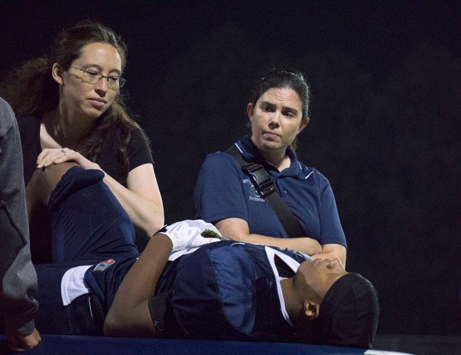 Rozanski looks on as her intern treats an injured Spartan.