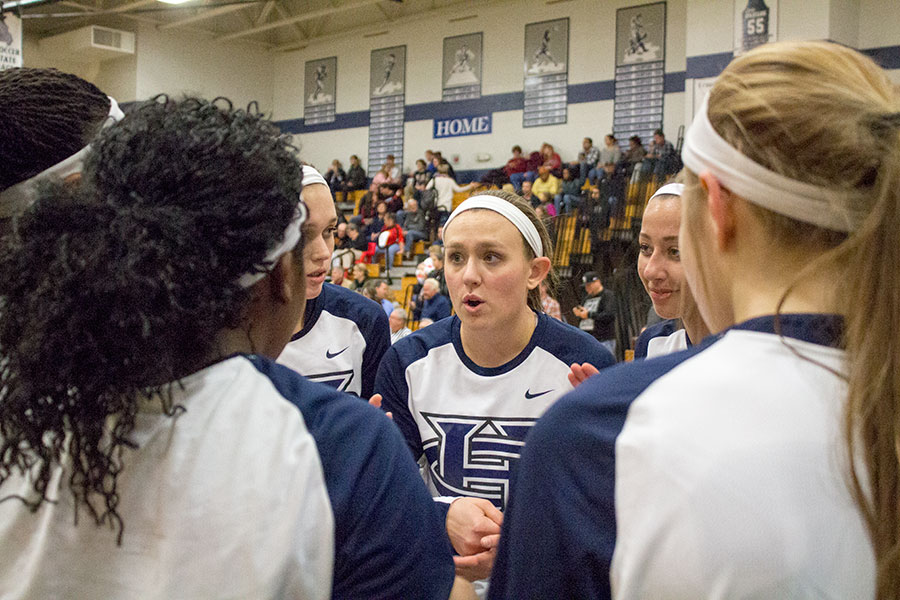 Small guard and leader Makenzie Schierding, senior, huddles with her teammates before a home game. The camaraderie between members of the varsity team greatly contributes to their shock-and-awe rapid playing style.