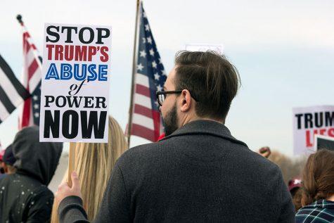 Protestors greet President Trump into St. Charles