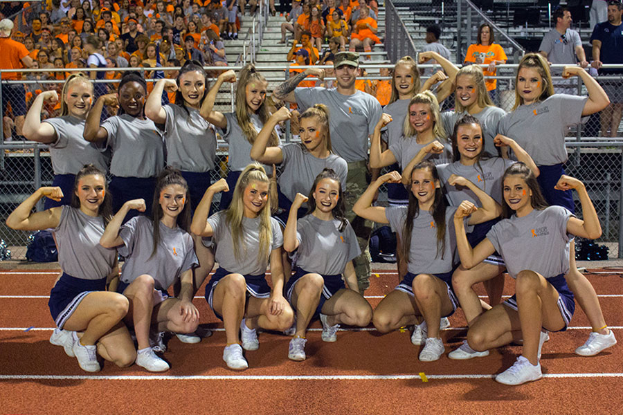 Sensations pose in support of their coach. The girls always keep their coach in their hearts.