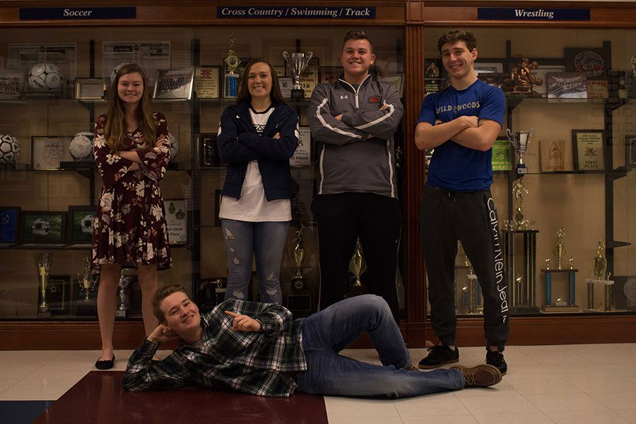These are five of the best players to watch this winter season. From left to right: Elizabeth Skelly, Makenzie Schierding, Colin Hepler, Weston Klein, (on the floor) Corey Moats.