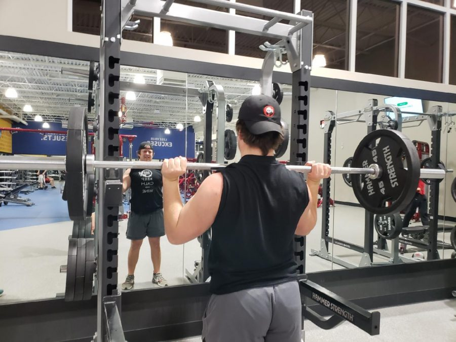 Senior Zac Bishop is working out is upper body muscles with a workout called,