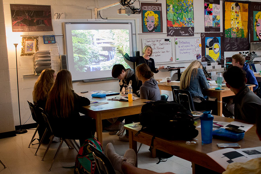 Speaking to her AP Art History class, shares information with her students about Fallingwater, a Frank Lloyd Wright home in Pennsylvania.