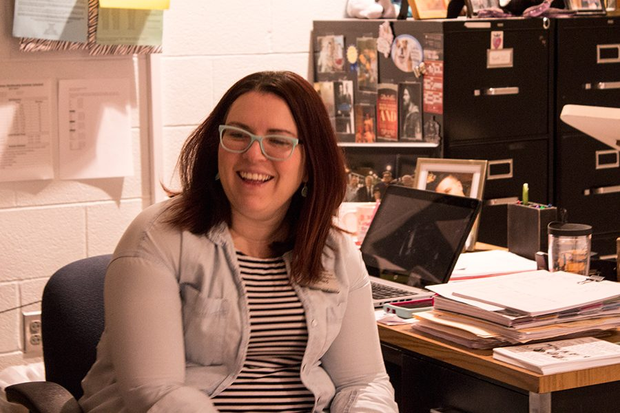 Ms.+Stallard+laughs+in+her+classroom.+Her+smile+lights+up+the+room.
