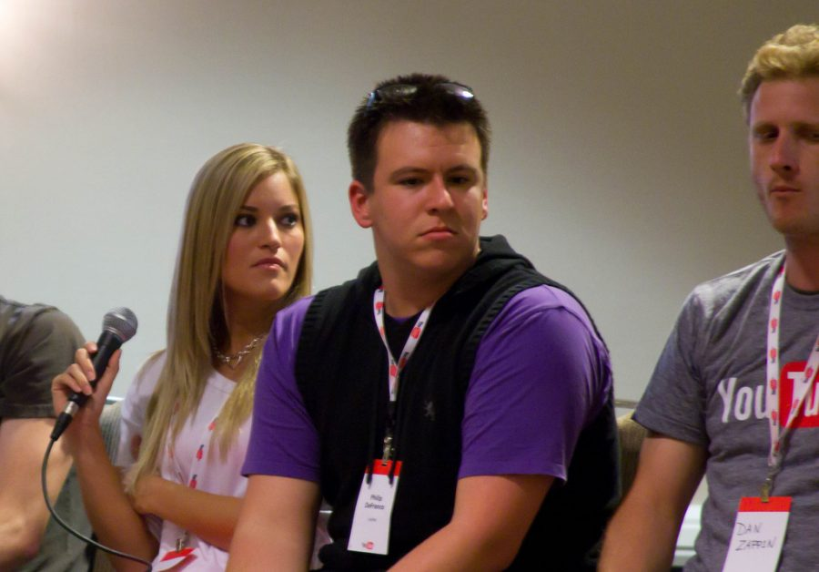 Philip Defranco gives an interview with his fellow you tubers at a meet up in 2010. He was sitting with IJusting (left)