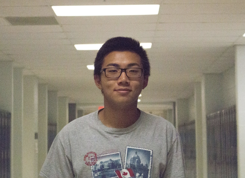 Swimmer Michael Yu poses for a headshot after giving an interview on what's new with Boys Swim.