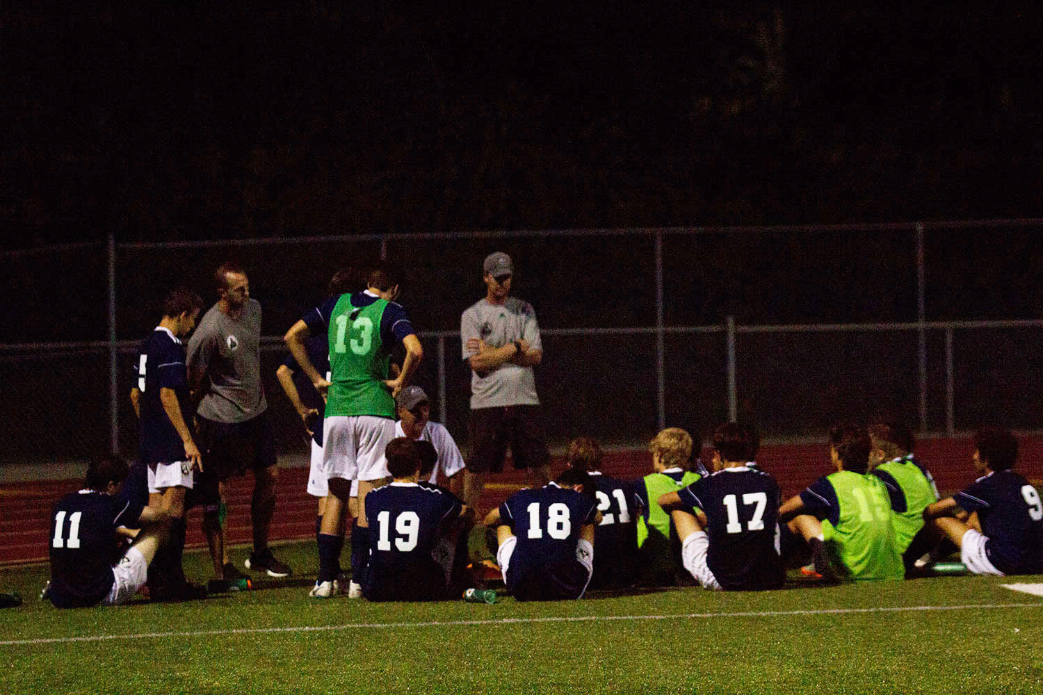 The team huddles together during halftime to discuss strategies for the second half.