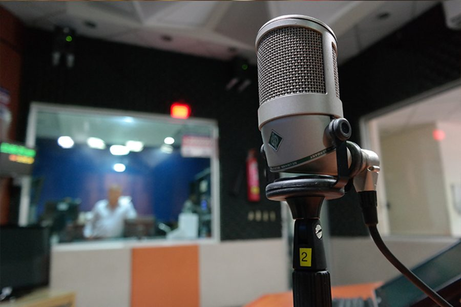A microphone sits in a recording studio. Professional equipment is very important for recording a quality podcast.