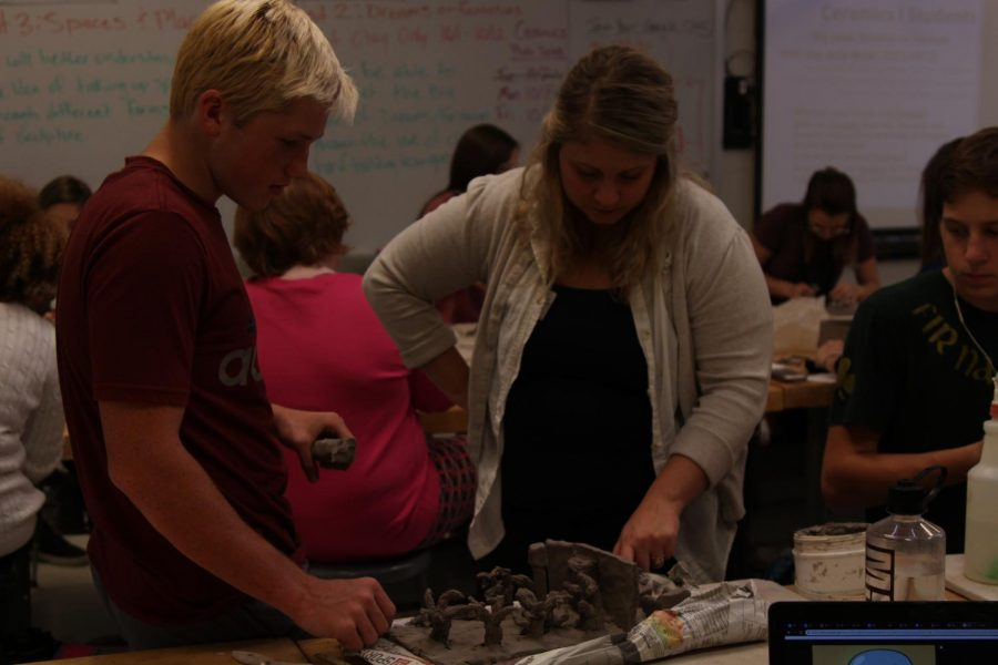 CREATE%3A+Mrs.Sprick+helps+a+student+during+her+first+hour+ceramic+class.+