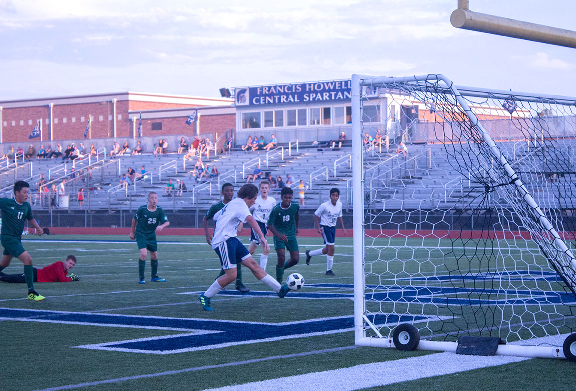 FHC player leaves behind goalkeeper at the top of the box to score goal.