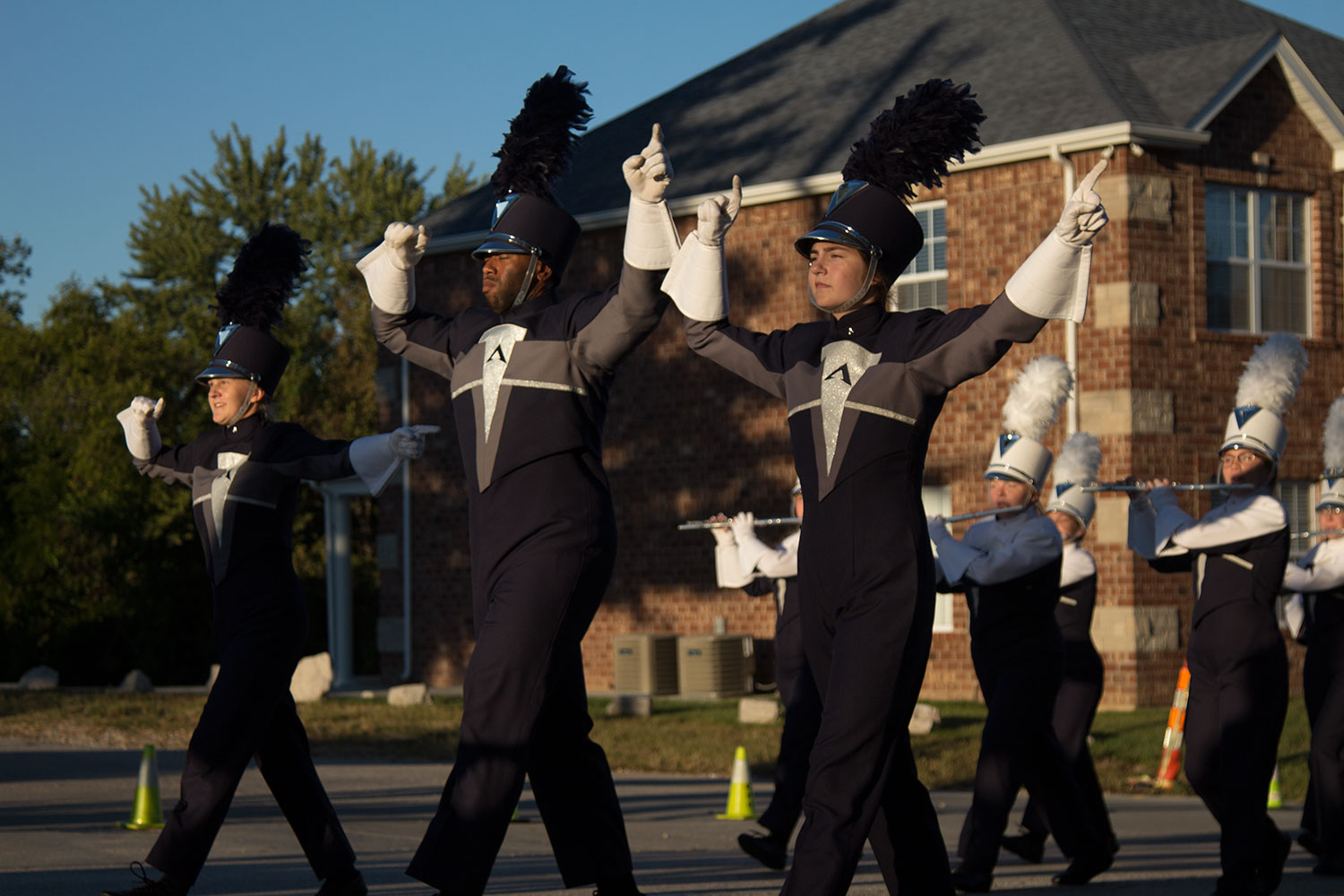 Abigail Tarleton, Austin Crudup, and Laurel Ammond lead the Spartan Bands during the Homecoming parade. Ammond was named to All State Honor Band Dec. 1.