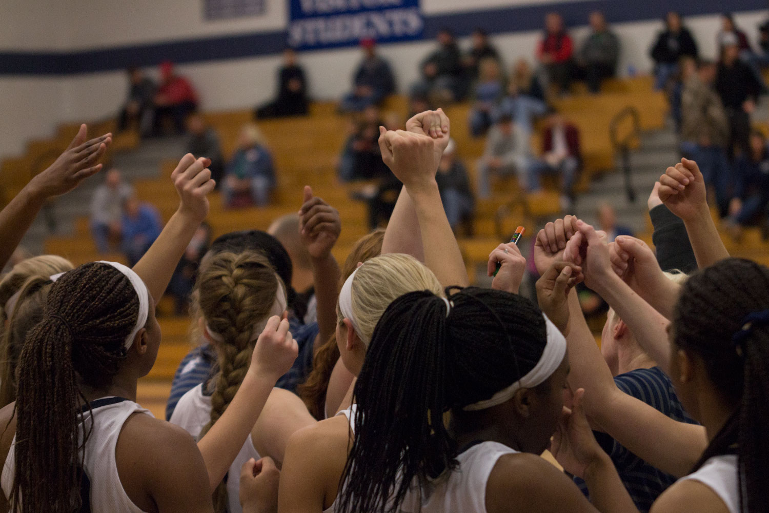 The Spartan girls huddle before their game; in which they won 48-14.