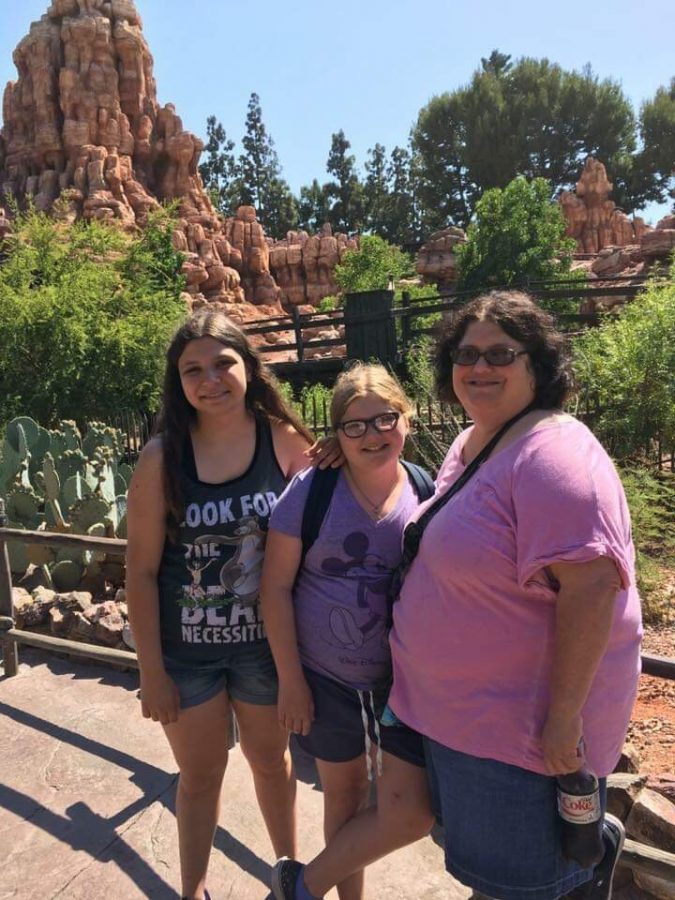 Sydney Love stands with her mother and sister while on vacation. Despite being sad that her parents separated, she recognizes they're both happier now.