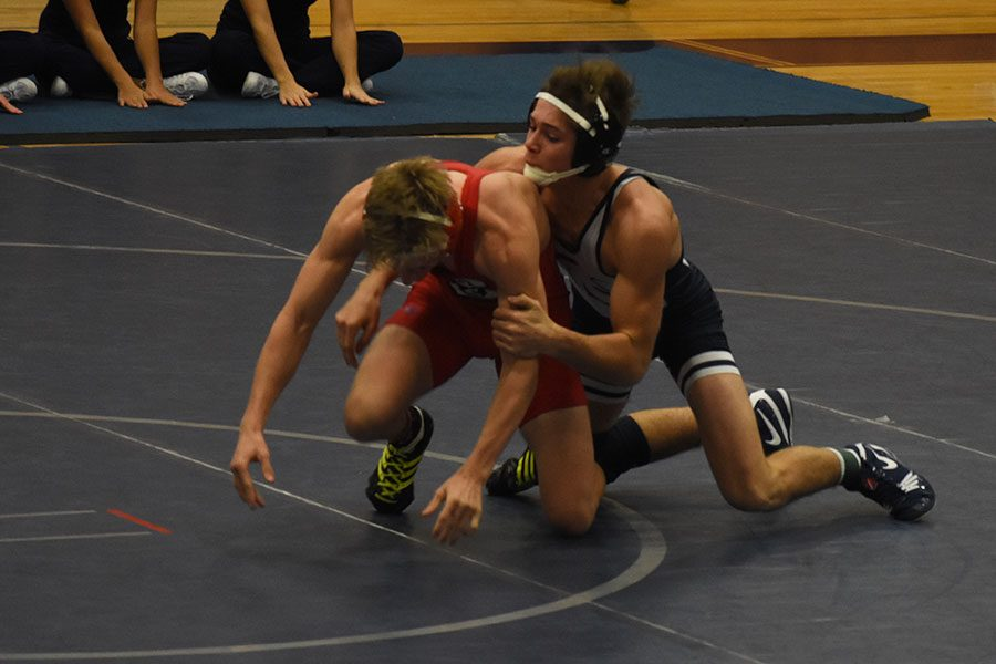 Wrestling takes a tough loss on home opener