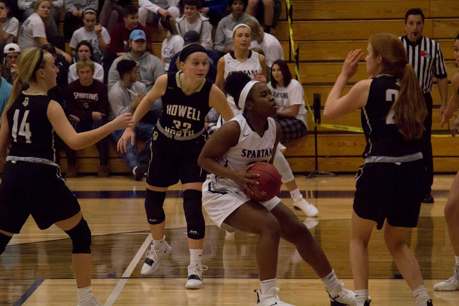 Azaria Hulbert drives to the hoop against four defenders. The Spartan offense has been dominant so far this season.