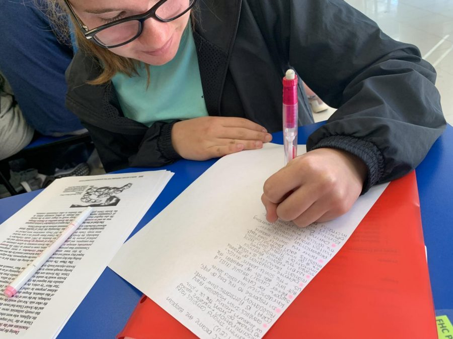 Natalie White is completely focused on finishing her AP World notes so that she may move on with her busy schedule of studying and soccer.