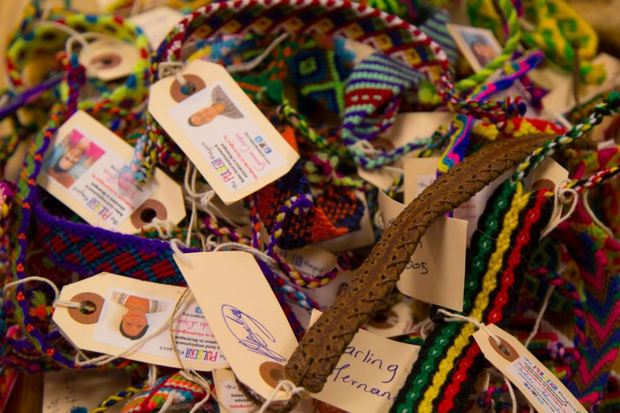 Spanish Honor Society bracelets, made by impoverished people in Nicaragua and Guatemala, sit, waiting to be sold by members. The club only started this year and is already finding ways to help spread happiness outside of the school.