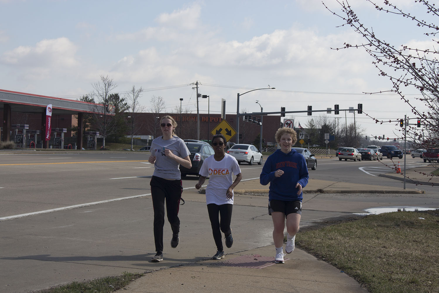 Three members of the girl's track team run alongside Mid Rivers Mall Drive. Their hard work has already been proven in the first three meets of the season, as there were many personal records broken.