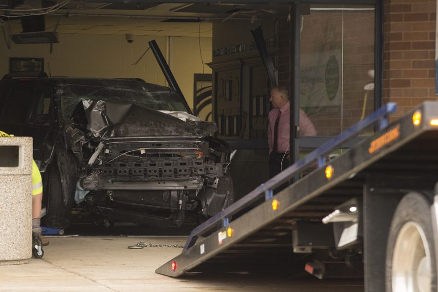 The perpetrator's car is removed away from the site of entry as Dr. Sonny Arnel watches on. The accident occurred at 3:45 a.m. and authorities were notified of the accident shortly afterwards.