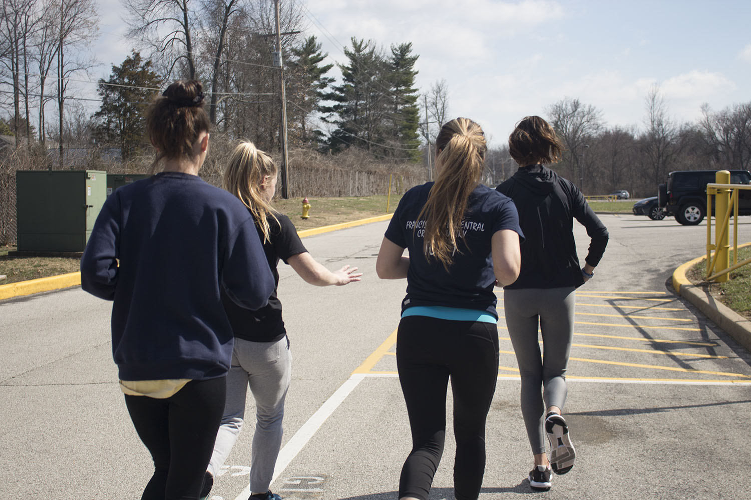 Four members of the track and field team run during practice to prepare their bodies for performance. This is part of what junior Mikayala Aubuchon attributes to their success.