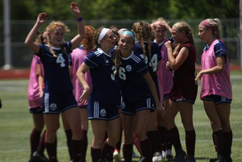 The girls soccer team celebrates after winning the District 4 Quarterfinals game against Howell