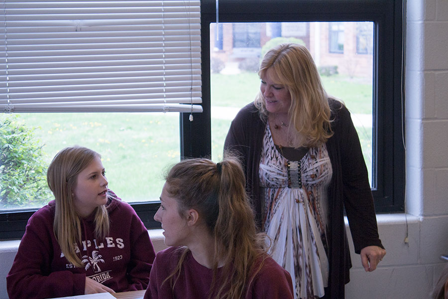 Mrs. Shockley talking with a student during class